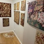 Some of Lynne's quilts hanging on the wall.