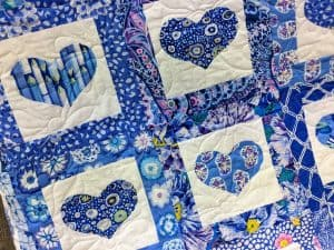 Vibrant blues heart quilt.