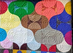 Colourful lantern quilted with swirl quilting.